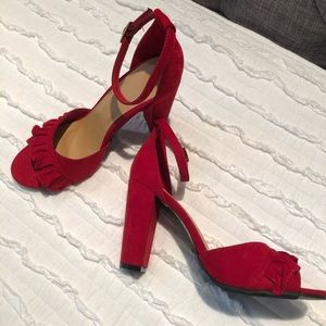 Red size 8 heels. Never worn